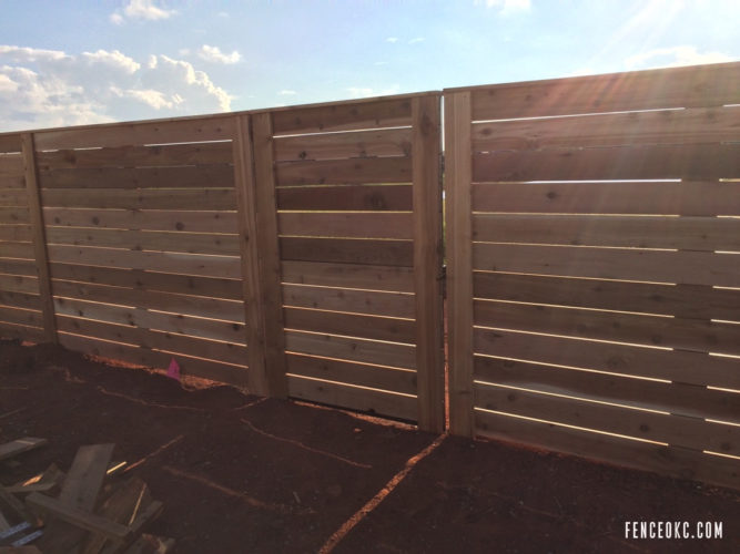 Close up Side View of Commercial 515' Cedar Horizontal Fence With Gate in Edmond, Oklahoma