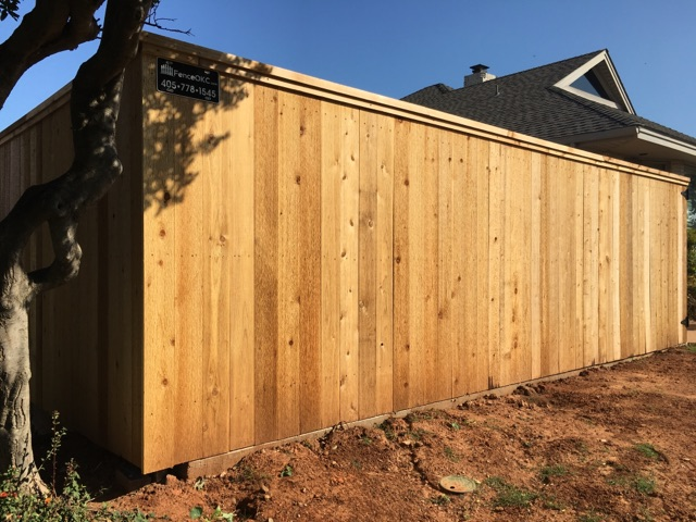 Custom 6' cap and trim residential cedar fence in our fence project gallery