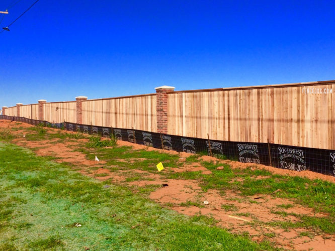 Commercial cedar fence with brick columns