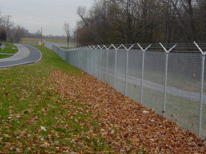 Chain link fence with barbwire on top