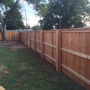Residential cedar fence with cap and trim