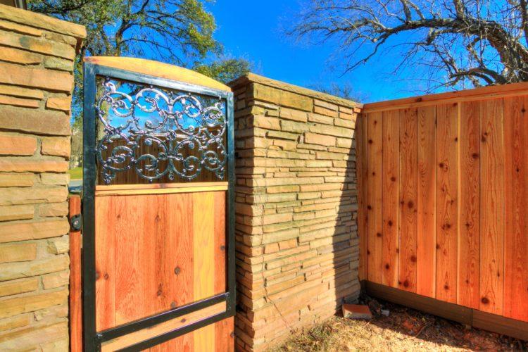 Cedar fence with custom ornamental iron and cedar gate with EZ brace