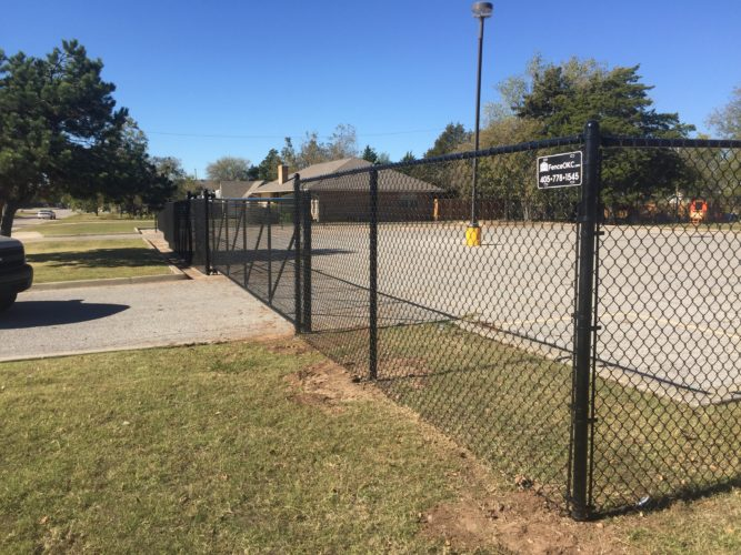 Chain link commercial fence installation services in central Oklahoma by Fence OKC.