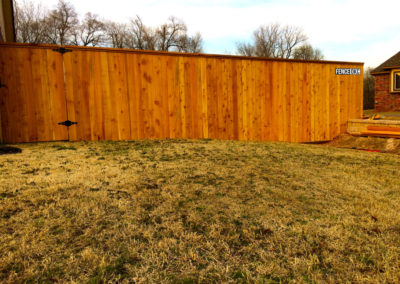 6' to 8' Transition Custom Cedar Cap and Trim Fence in Norman Oklahoma