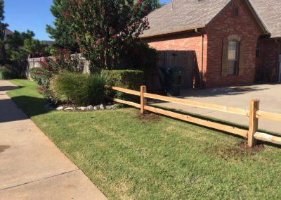 2 rail cedar split rail fence installed in Yukon, Oklahoma by Fence OKC.