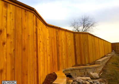 6' to 8' Transition Custom Cedar Cap and Trim Fence Over Strom Drain in Norman Oklahoma