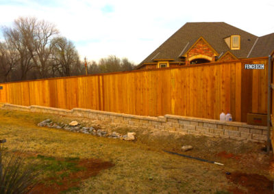 Beautiful 6' to 8' Transition Custom Cedar Cap and Trim Fence Over Strom Drain in Norman Oklahoma