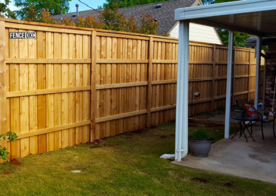 8' Cedar Board on Board Stockade Fence With Postmaster Posts  and Cap & Trim