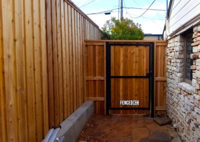 6' Custom Cedar Cap & Trim Steel Frame Gate with 8' Cedar Board on Board Cap & Trim Stockaded Fence