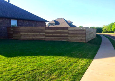 6' Horizontal Custom Cedar Fence Installed with Postmaster Posts.