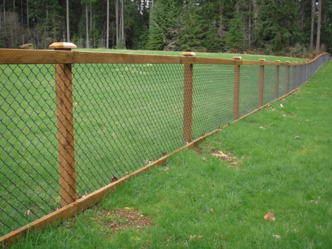 Chain link combined with wood slats to make a beautiful fence