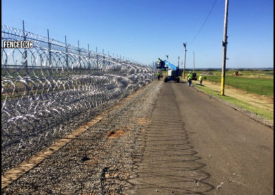 12' + 1' Chain Link Federal Prison Fence with 3 rows of razor wire.