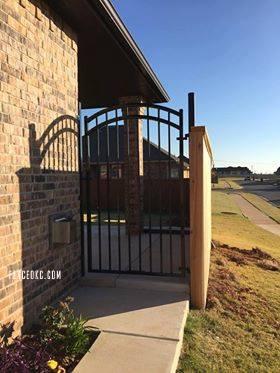 Iron gate and custom 6' cedar fence with cap and trim built in Oklahoma City OK