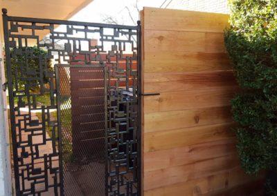 Custom Iron Gate with Horizontal Cedar Fence
