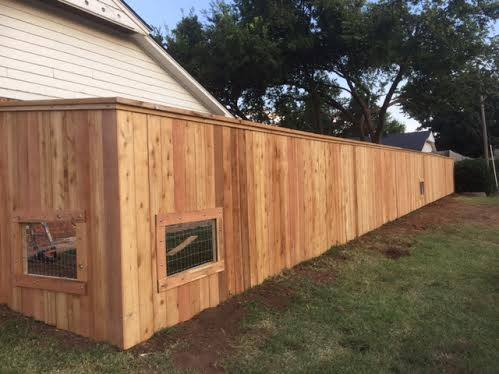 Cap and Trim Cedar Fence with Custom Dog Windows