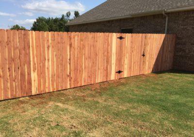 6' Superior Cedar stockade fence installed with EZBrace walk though gate in Yukon, Oklahoma.