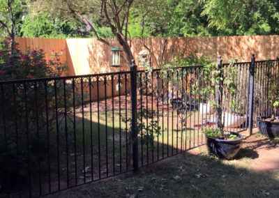 Ornamental iron fence and two step cedar fence installed in OKC Oklahoma