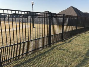 Some styles of ornamental iron will make a beautiful small dog fence.