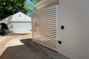 Hand built custom metal automated driveway gate by Fence OKC.