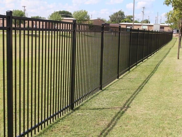 Commercial ornamental iron fence installed by Fence OKC.